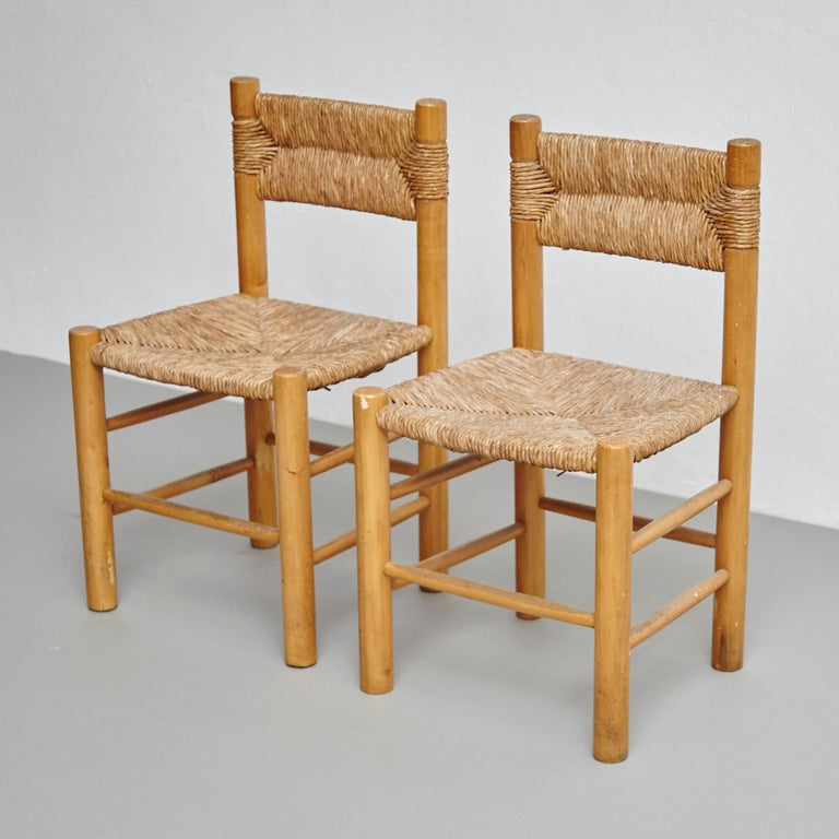 After Charlotte Perriand Mid-Century Modern Rattan Pair of Chairs, circa 1950 In Good Condition In Barcelona, Barcelona
