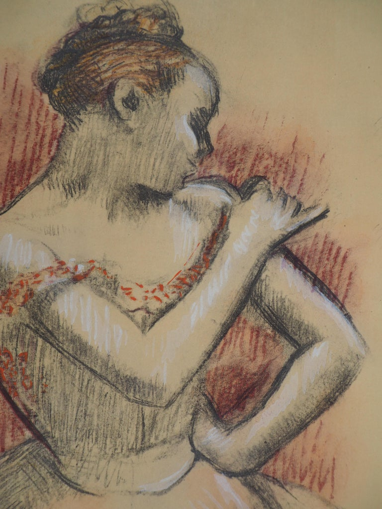 Edgar DEGAS (after) Ballerina Adjusting her Dress   Lithograph and Watercolor stencil Printed signature in the plate  On paper mounted on vellum 38 x 30 cm (c. 15 x 12 inch) Edited by Jacomet in 1957 and limited to 600 unumbered copies  Excellent