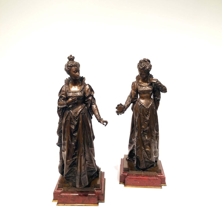 """After Eutrope Bouret (French, 1833-1906) Elizabeth I and Mary Queen of Scotts. Patinated bronze on rouge marble base. Signed """"Bouret"""" to the lower left. Dimensions: 7.0"""