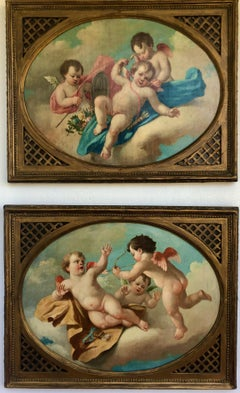 Pair Of 18th Century Cherub Putti Playing With Bow And Arrow