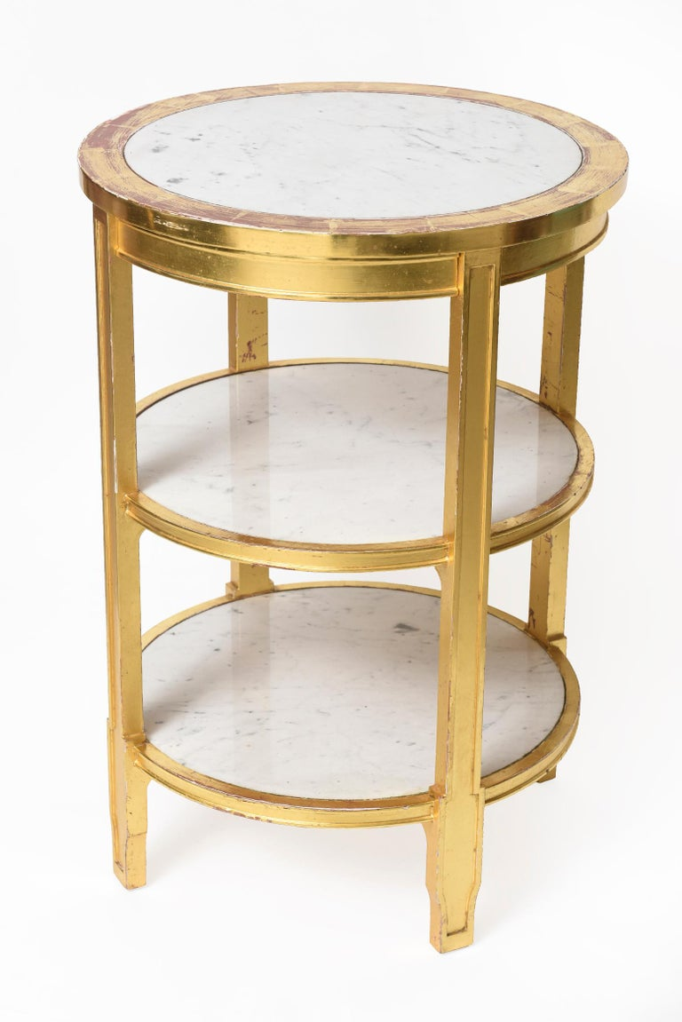 This beautiful tier table is a replica of a piece from Nelson Rockefeller's private collection. In 1937 Jean-Michel Frank designed Nelson Rockefeller's famed Fifth Avenue apartment. During this time, he created many of his famous pieces. This