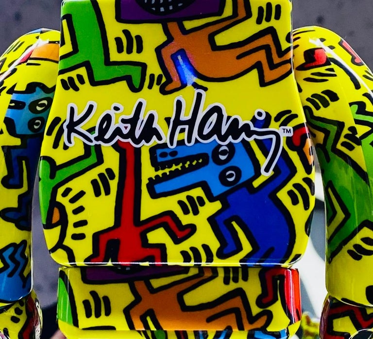Keith Haring Bearbrick Vinyl Figures: Set of two (400% & 100%): A unique, timeless collectible trademarked & licensed by the Estate of Keith Haring. The partnered collectible reveals the late iconic artist's artwork from the mid 1980s wrapping the