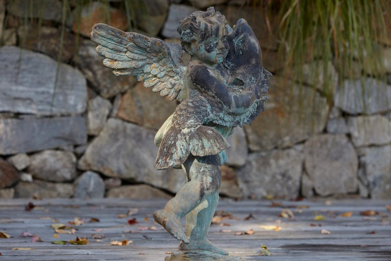 After Verrocchio, Detailed Bronze Water Garden Statue of Cherub and Fish, 1940s In Good Condition For Sale In Weston, CT