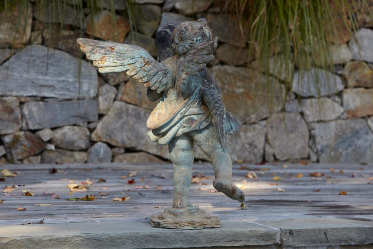 Mid-20th Century After Verrocchio, Detailed Bronze Water Garden Statue of Cherub and Fish, 1940s For Sale