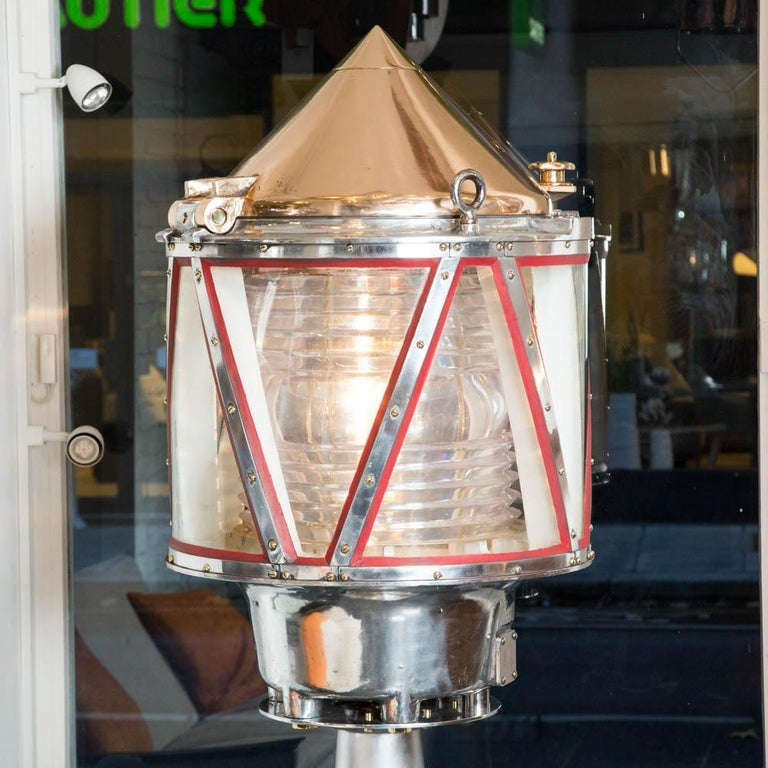 A large channel marker or lightship light, made by AGA, (American Gas Accumulator Co.) on pedestal stand with a replaced perspex Fresnel drum lens.   Frame marked AGA, cast in a number of places.  There similar lights in museums, such as the