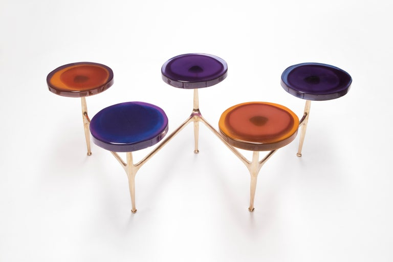 Transparency Matters collection by Draga & Aurel: Coffee table, formed from cast resin and cast bronze. The process of creating the transparent and colourful tops requires a special technique of casting resin into the mould in three layers of