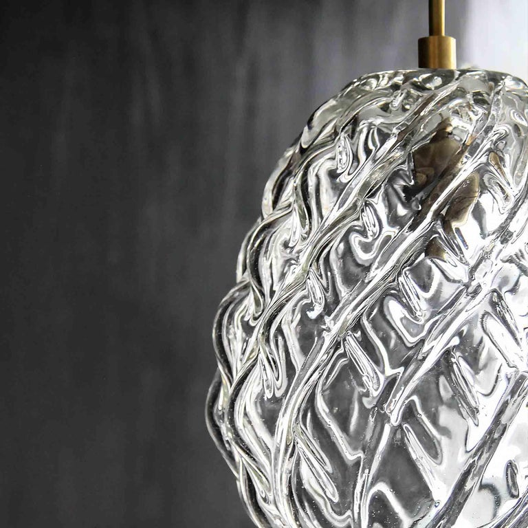 This collection is inspired by the distinctive shape and character of the piña—the heart of the agave plant—from which mezcal is made. Each lamp is individually and expertly coaxed to form in Oaxaca, where mezcal has played a vital spiritual and