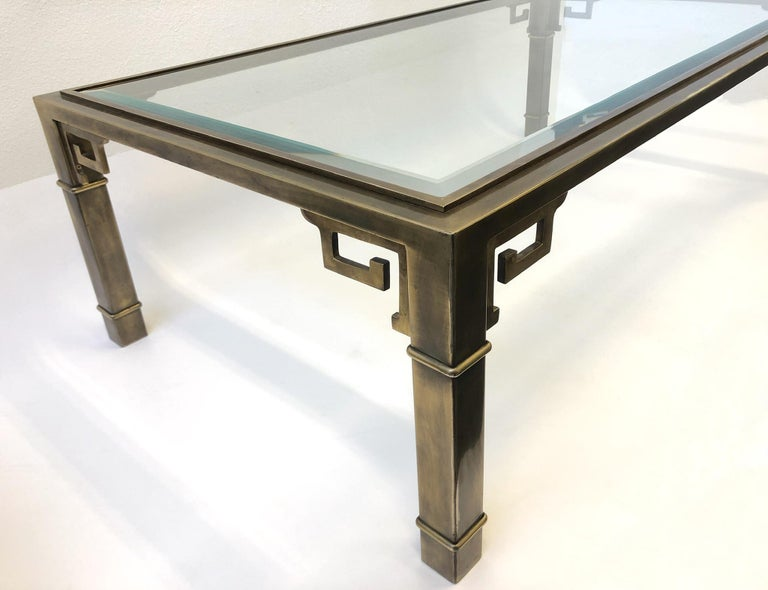 Beveled Aged Brass and Glass Greek Key Cocktail Table by Mastercraft For Sale
