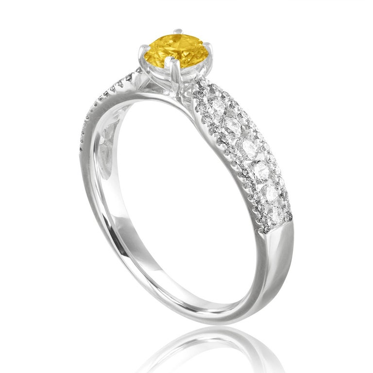 Beautiful Sapphire Ring The ring is 18K White Gold The Center Stone is a Round Yellow Sapphire 0.42 Carats The Sapphire is AGL Certified Heated There are 0.51 Carats in Diamonds F/G VS/SI The ring is a size 6.50, sizable The ring weighs 2.6 grams