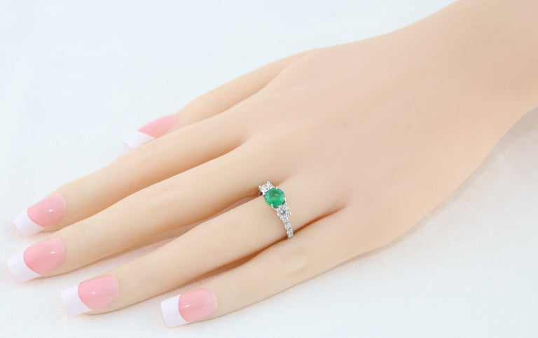 Contemporary AGL Certified 0.77 Carat Emerald Three-Stone Diamond Gold Ring For Sale