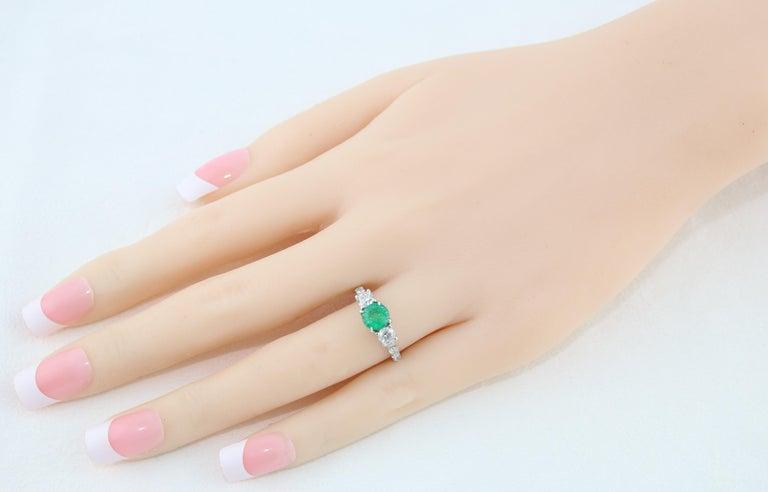 Women's AGL Certified 0.77 Carat Emerald Three-Stone Diamond Gold Ring For Sale