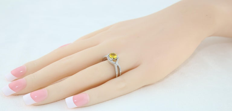 Women's AGL Certified 0.77 Carat Round Yellow Sapphire and Diamond Gold Ring For Sale