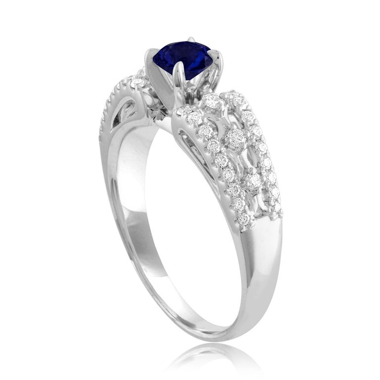 Beautiful Sapphire Ring The ring is 18K White Gold The Center Stone is a Round Blue Sapphire 0.80 Carats The Sapphire is AGL Certified Heated There are 0.33 Carats in Diamonds F/G VS/SI The ring is a size 6.75, sizable The ring weighs 4.8 grams
