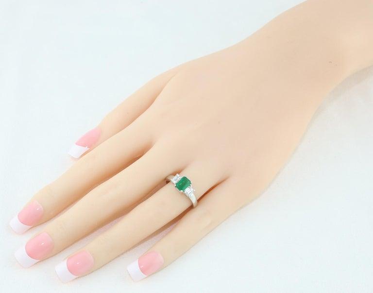 Emerald Cut AGL Certified 0.84 Carat Emerald Three-Stone Diamond Gold Ring For Sale
