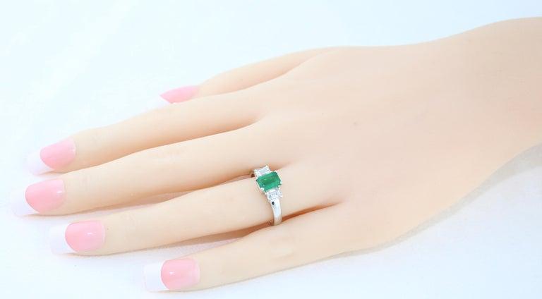 Women's AGL Certified 0.84 Carat Emerald Three-Stone Diamond Gold Ring For Sale