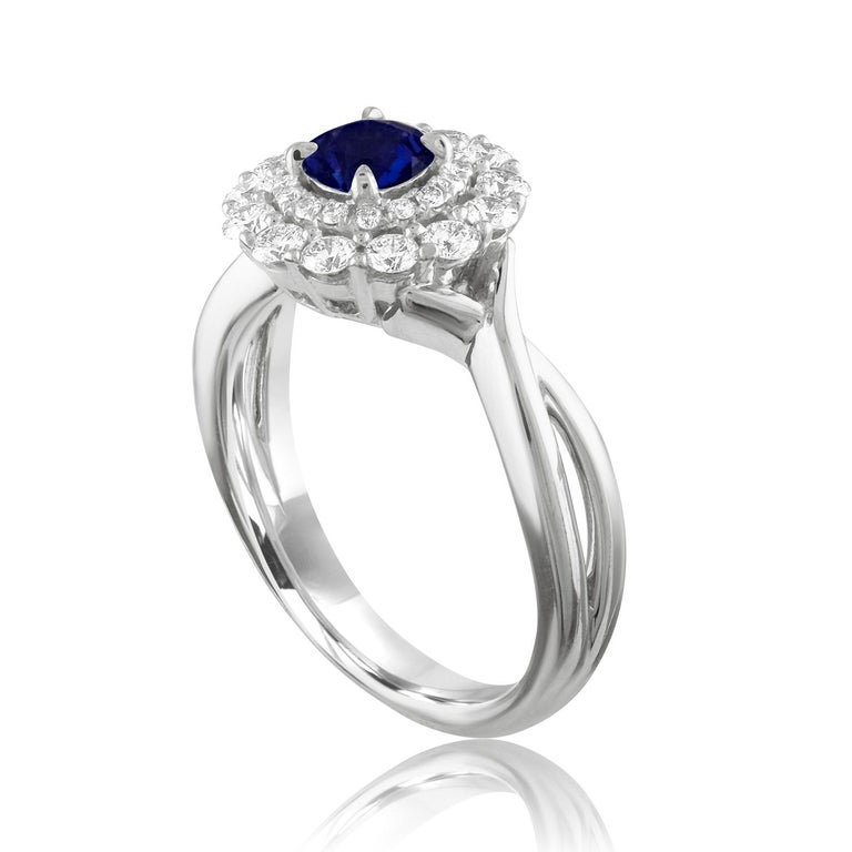 Beautiful Double Halo Ring The ring is 18K White Gold The Center Stone is a Round Blue Sapphire 0.84 Carats The Sapphire is AGL Certified Heated There are 0.52 Carats in Diamonds F/G VS/SI The ring is a size 6.5, sizable The ring weighs 6.0 grams