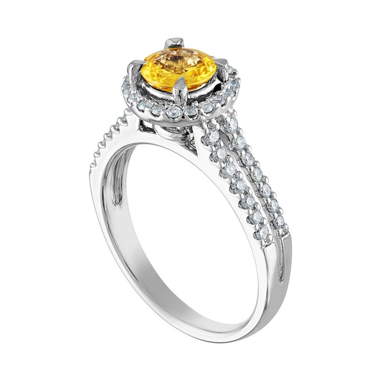 Beautiful Halo Ring The ring is 18K White Gold The Center Stone is a Round Yellow Sapphire 0.84 Carats The Sapphire is AGL Certified Heated There are 0.41 Carats in Diamonds F/G VS/SI The ring is a size 6.5, sizable The ring weighs 5.3 grams