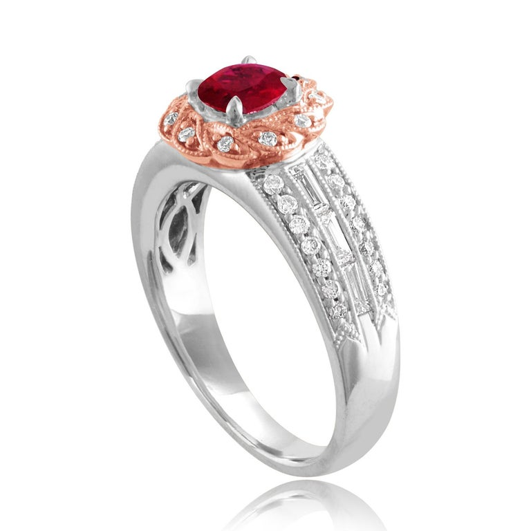 Beautiful Round Halo Two Tone Milgrain Ring The ring is 18K White & Rose Gold The Center Stone is a Round Ruby 0.86 Carats The Ruby is AGL Certified Heated There are 0.53 Carats in Diamonds F/G VS/SI The ring is a size 6.75, sizable The ring weighs