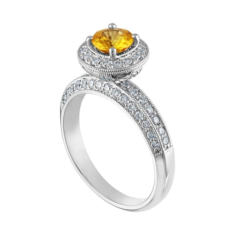 Beautiful Art Deco Revival Round Halo Milgrain Ring The ring is 14K White Gold The Center Stone is a Round Yellow Sapphire 0.86 Carats The Sapphire is AGL Certified Heated There are 0.85 Carats in Diamonds F/G VS/SI The ring is a size 7.00,
