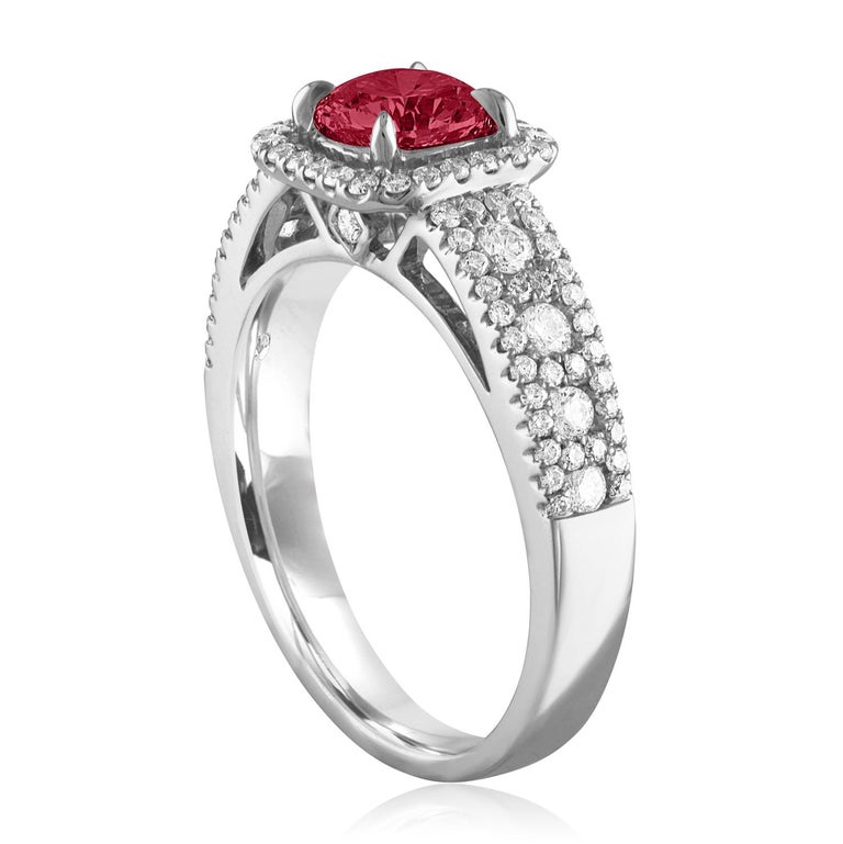 Beautiful Square Halo Ring The ring is 18K White Gold The Center Stone is a Round Ruby 0.87 Carats The Ruby is AGL Certified Heated There are 0.56 Carats in Diamonds F/G VS/SI The ring is a size 6.5, sizable The ring weighs 4.3 grams
