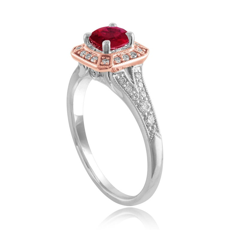 Beautiful Square Halo Two Tone Milgrain Ring The ring is 18K White & Rose Gold The Center Stone is a Round Ruby 0.88 Carats The Ruby is AGL Certified Heated There are 0.27 Carats in Diamonds F/G VS/SI The ring is a size 6.75, sizable The ring weighs