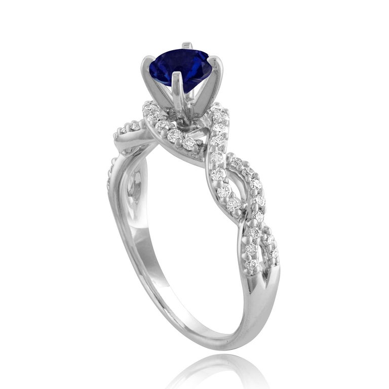 Beautiful Infinity Shank Sapphire Ring The ring is 18K White Gold The Center Stone is a Round Blue Sapphire 0.88 Carats The Sapphire is AGL Certified Heated There are 0.33 Carats in Diamonds F/G VS/SI The ring is a size 6.75, sizable The ring weighs