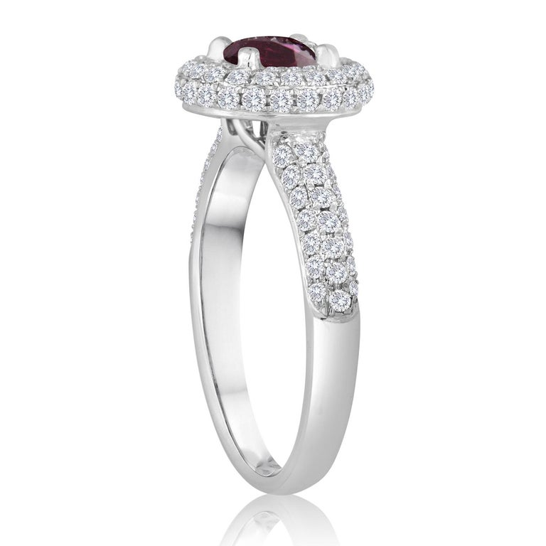 Beautiful Round Halo Pave Ring The ring is 18K White Gold The Center Stone is a Round Ruby 0.89 Carats The Ruby is AGL Certified Heated There are 0.81 Carats in Diamonds F/G VS/SI The ring is a size 6.75, sizable The ring weighs 4.0 grams