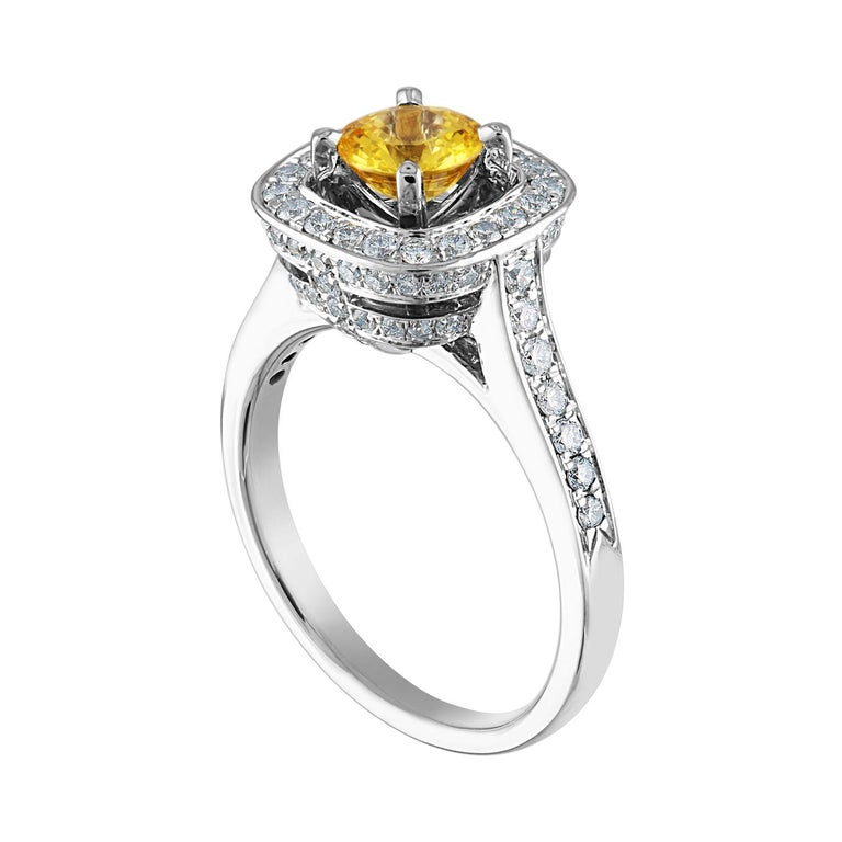 Beautiful Square Halo Ring The ring is 18K White Gold The Center Stone is a Round Yellow Sapphire 0.92 Carats The Sapphire is AGL Certified Heated There are 0.69 Carats in Diamonds F/G VS/SI The ring is a size 7.25, sizable The ring weighs 6.2 grams