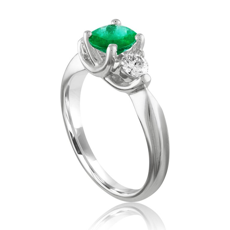 Beautiful 3 Stone Emerald Ring The ring is 18K White Gold. The Center is a beautiful Round 0.96 Carat Emerald. The Emerald is AGL certified. There are 2 side stones 0.37 Carats Diamonds F/G VS/SI The ring is a size 6.50, sizable. The ring weighs 4.6