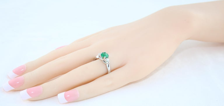 Women's AGL Certified 0.96 Carat Emerald Three-Stone Diamond Gold Ring For Sale