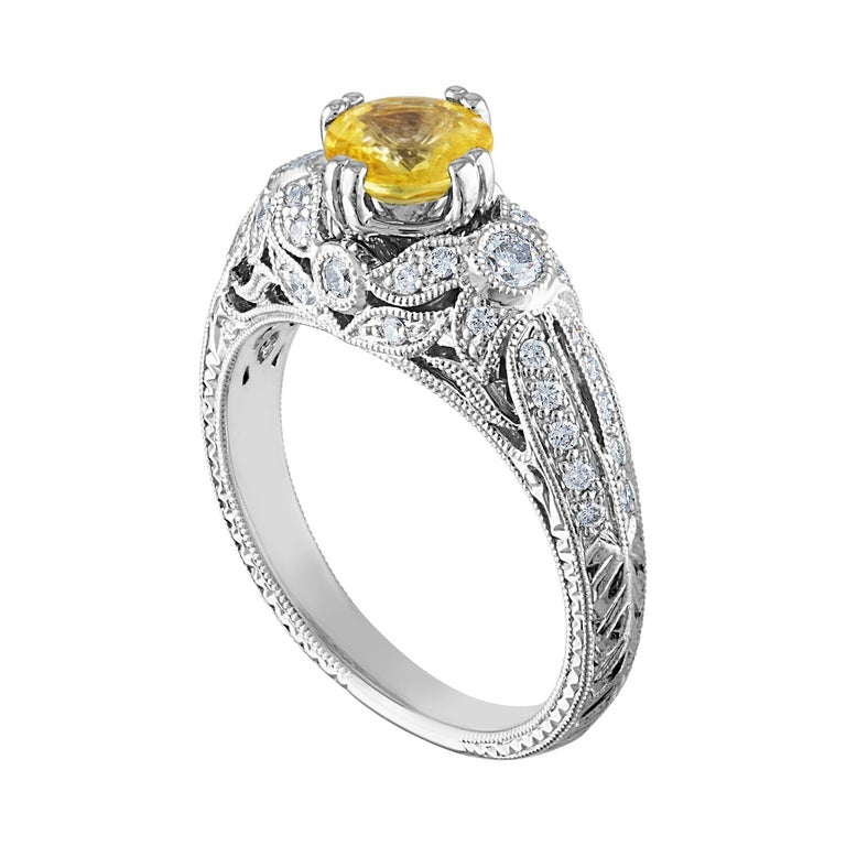 Beautiful Art Deco Revival Round Milgrain Filigree Ring The ring is 18K White Gold The Center Stone is a Round Yellow Sapphire 0.97 Carats The Sapphire is AGL Certified Heated There are 0.45 Carats in Diamonds F/G VS/SI The ring is a size 6.75,