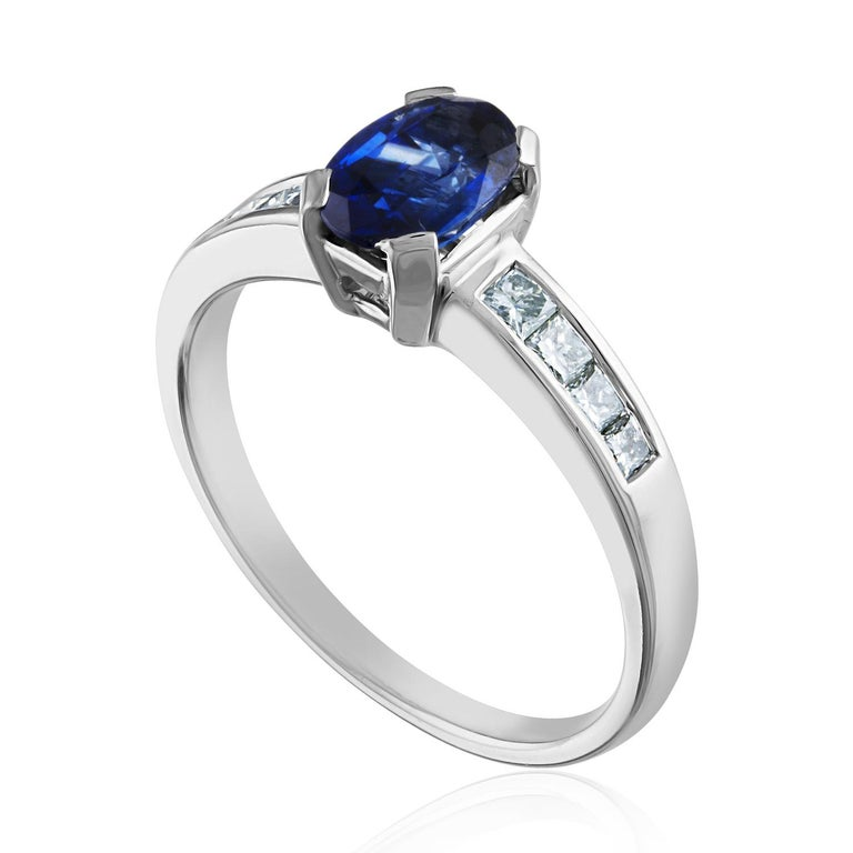 Beautiful Blue Sapphire Ring. The ring is 18K White Gold. The Blue Sapphire is Oval 0.98 Carat. The stone is AGL Certified, The stone is Heated. There are 0.31 Carat Diamonds F/G VS/SI. The ring is a size 6.50, sizable. The ring weighs 3.3 grams