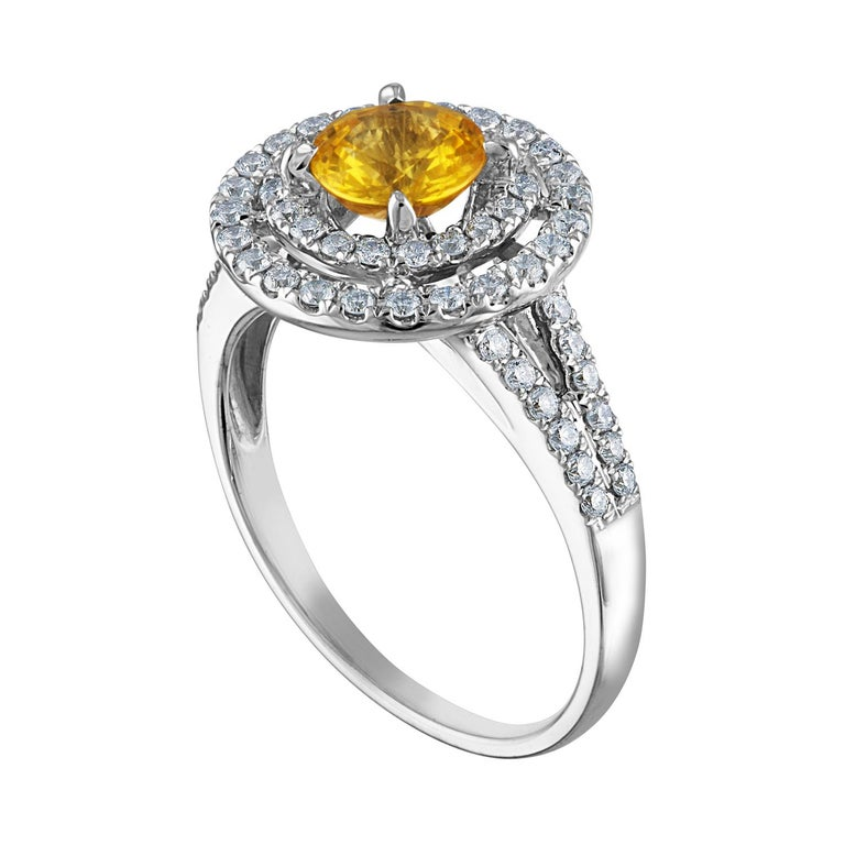 Beautiful Double Halo Ring The ring is 14K White Gold The Center Stone is a Round Yellow Sapphire 0.98 Carats The Sapphire is AGL Certified Heated There are 0.70 Carats in Diamonds F/G VS/SI The ring is a size 6.5, sizable The ring weighs 4.0 grams