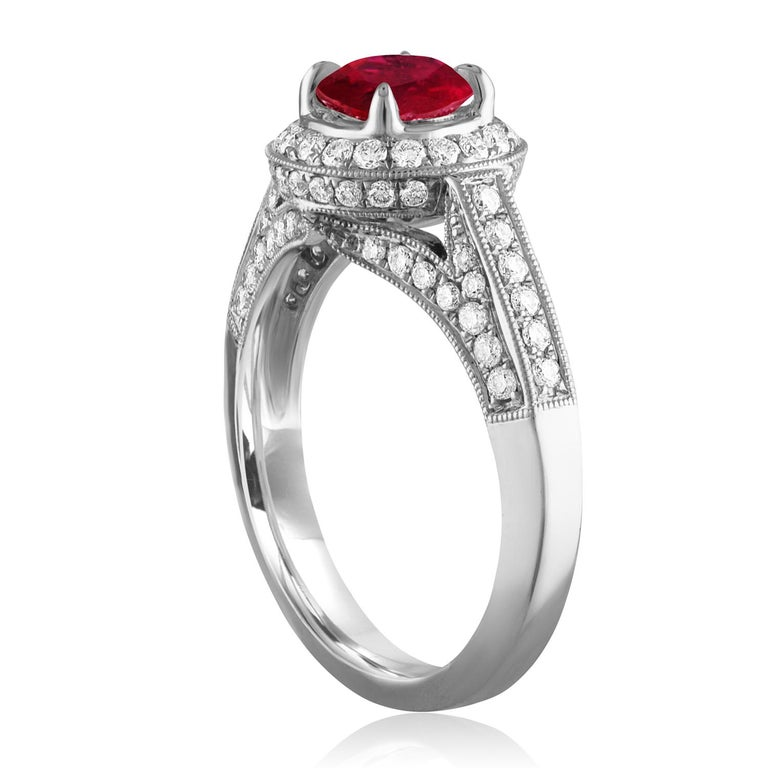 Beautiful Art Deco Revival Round Halo Milgrain Ring The ring is 18K White Gold The Center Stone is a Round Ruby 0.99 Carats The Ruby is AGL Certified Heated There are 0.64 Carats in Diamonds F/G VS/SI The ring is a size 6.50, sizable The ring weighs