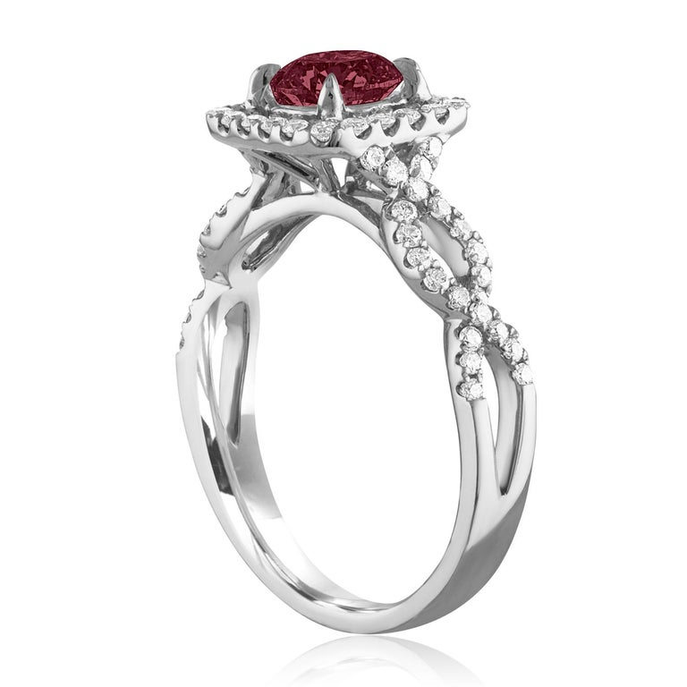 Beautiful Square Halo With Criss Cross Shank Ring The ring is 18K White Gold The Center Stone is a Round Ruby 1.04 Carats The Ruby is AGL Certified Heated There are 0.44 Carats in Diamonds F/G VS/SI The ring is a size 6.5, sizable The ring weighs