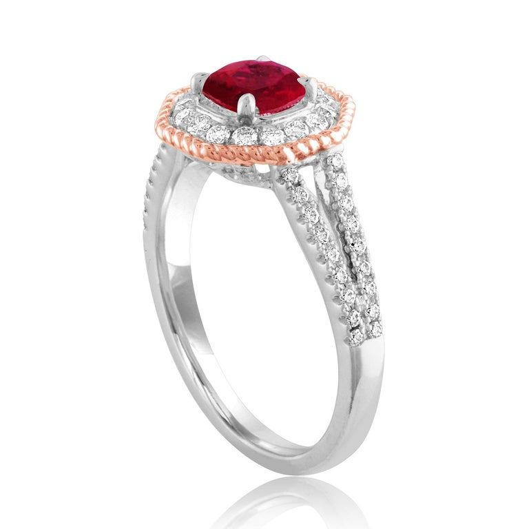 Beautiful Octagon Halo Two Tone Ring The ring is 18K White & Rose Gold The Center Stone is a Round Ruby 1.05 Carats The Ruby is AGL Certified Heated There are 0.68 Carats in Diamonds F/G VS/SI The ring is a size 6.5, sizable The ring weighs 4.7 grams