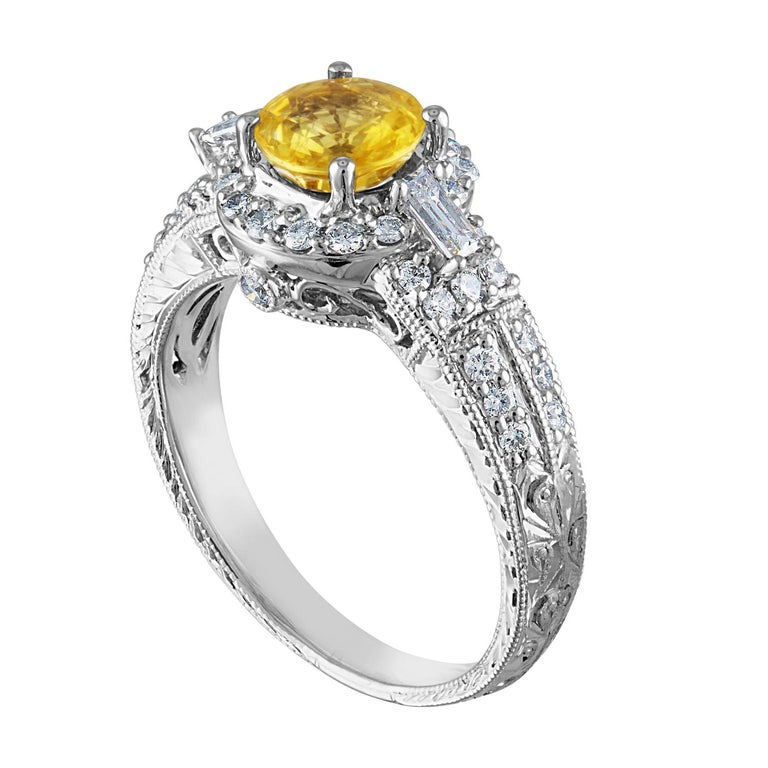 Beautiful Art Deco Revival Round Halo Milgrain Filigree Ring The ring is 18K White Gold The Center Stone is a Round Yellow Sapphire 1.05 Carats The Sapphire is AGL Certified Heated There are 0.45 Carats in Diamonds F/G VS/SI The ring is a size 5.50,