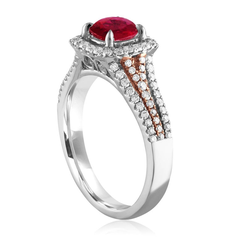 Beautiful Square Halo Two Tone Ring The ring is 18K White & Rose Gold The Center Stone is a Round Ruby 1.09 Carats The Ruby is AGL Certified Heated There are 0.54 Carats in Diamonds F/G VS/SI The ring is a size 6.5, sizable The ring weighs 4.4 grams
