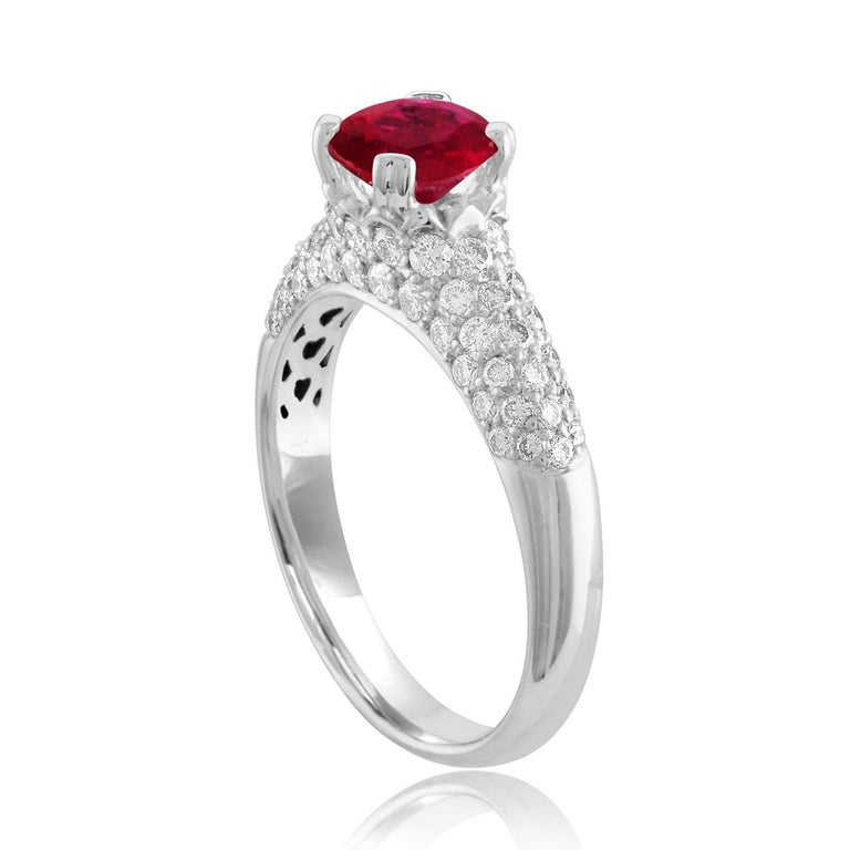 Beautiful Pave Ring The ring is 18K White Gold The Center Stone is a Round Ruby 1.14 Carats The Ruby is AGL Certified Heated There are 0.77 Carats in Diamonds F/G VS/SI The ring is a size 6.75, sizable The ring weighs 4.2 grams