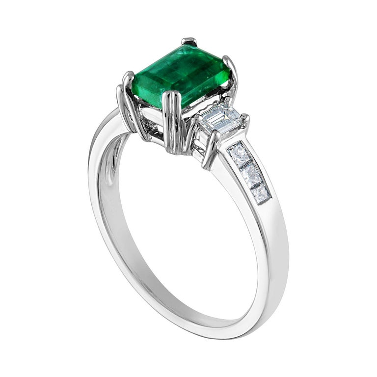 Beautiful 3 Stone Emerald Ring The ring is 18K White Gold. The Center is a beautiful emerald cut 1.15 Carat Emerald. The Emerald is AGL certified. There are 0.46 Carats Diamonds F/G VS/SI The ring is a size 7.00, sizable. The ring weighs 4.1 grams.