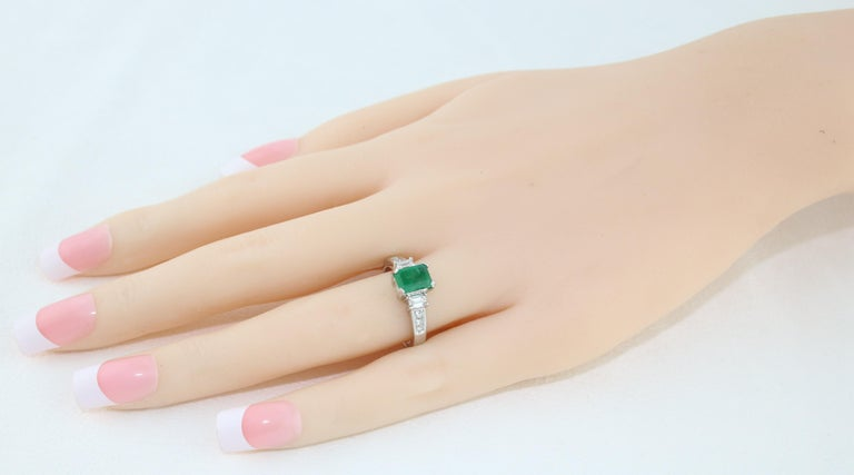 Contemporary AGL Certified 1.15 Carat Emerald Three-Stone Diamond Gold Ring For Sale