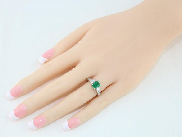 Emerald Cut AGL Certified 1.15 Carat Emerald Three-Stone Diamond Gold Ring For Sale