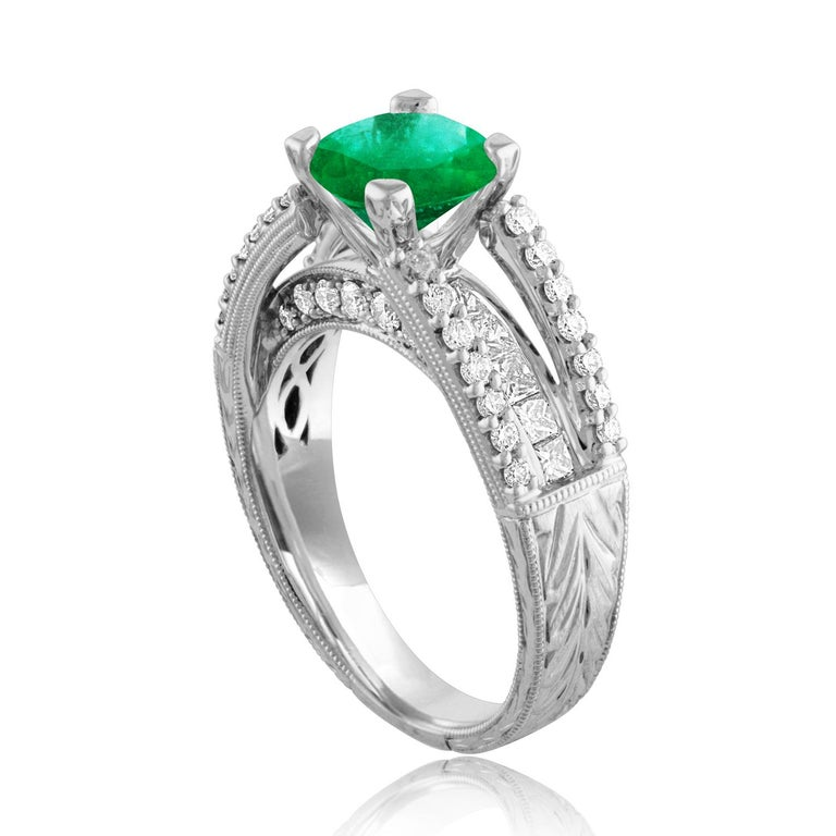 Beautiful Art Deco Revival Round Milgrain Filigree Ring The ring is 18K White Gold The Center Stone is a Round Emeralds 1.30 Carats The Emerald is AGL Certified Heated There are 0.95 Carats in Diamonds F/G VS/SI The ring is a size 6.75, sizable The