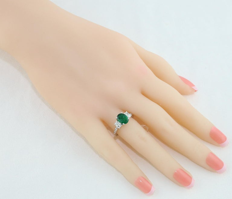 Contemporary AGL Certified 1.55 Carat Oval Emerald Three-Stone Diamond Gold Ring For Sale