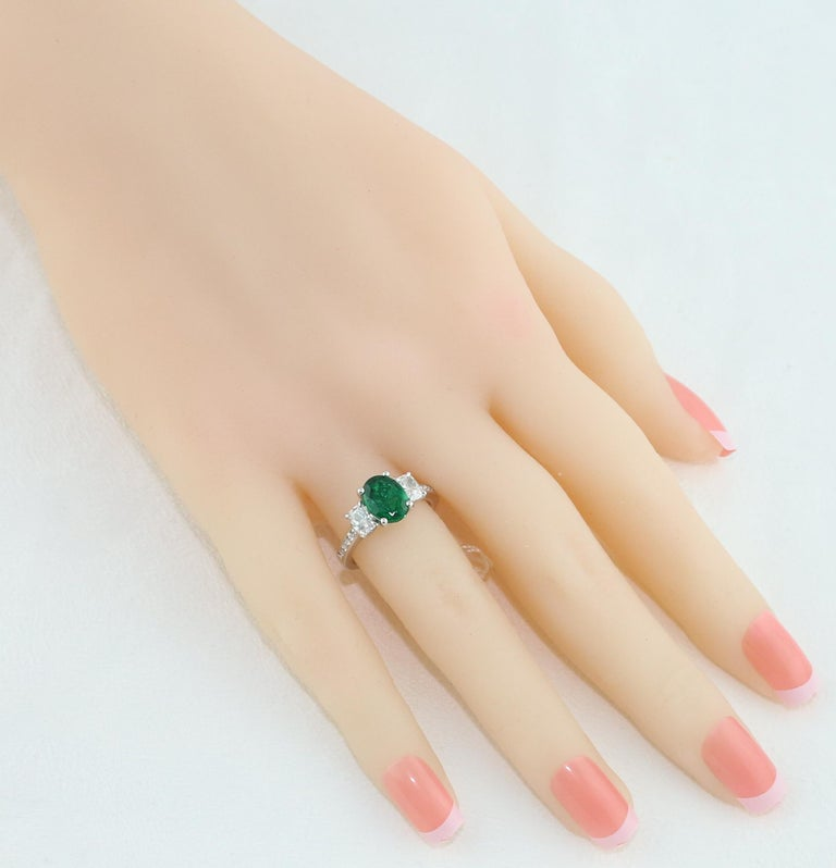 Oval Cut AGL Certified 1.55 Carat Oval Emerald Three-Stone Diamond Gold Ring For Sale