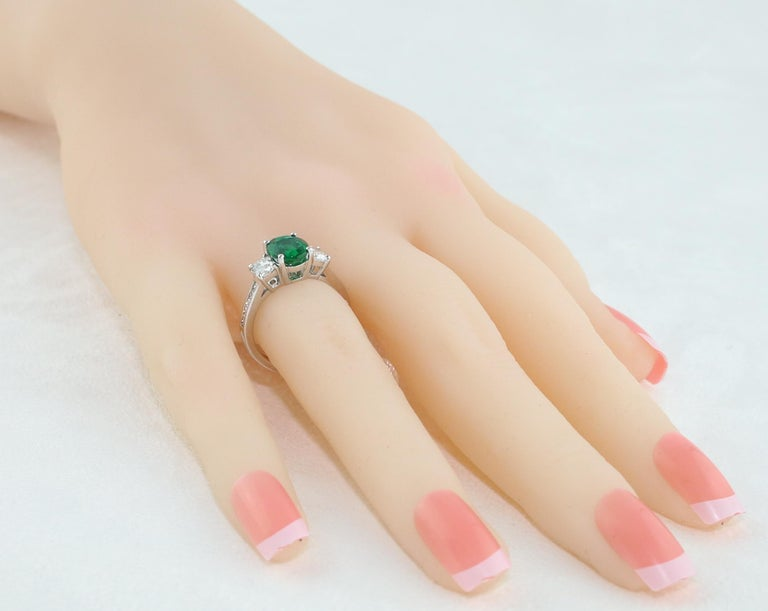 Women's AGL Certified 1.55 Carat Oval Emerald Three-Stone Diamond Gold Ring For Sale