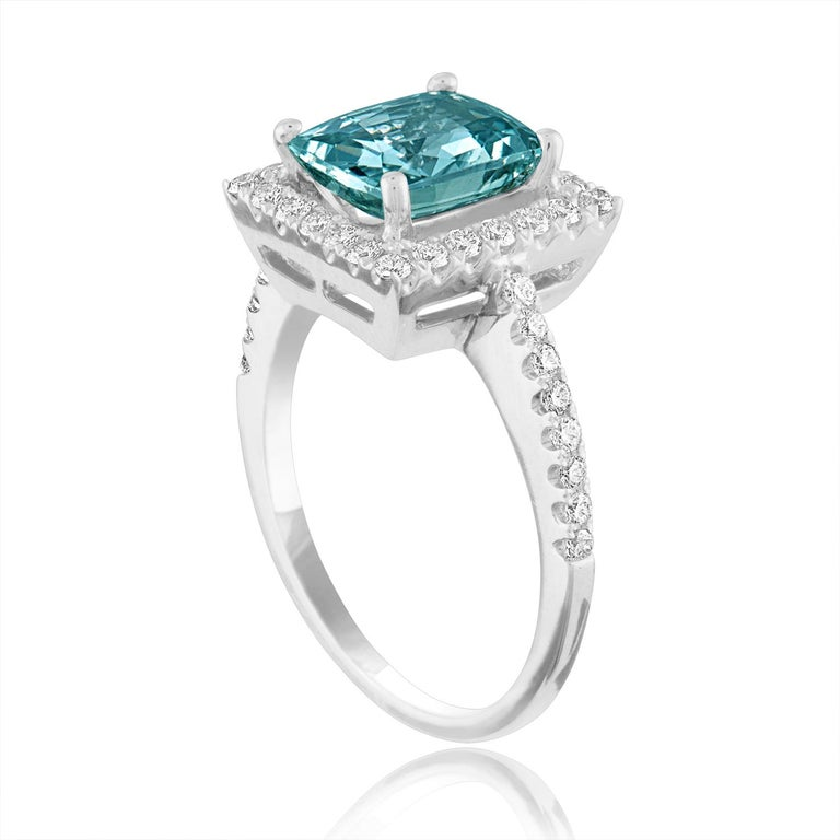 Beautiful Cushion Cut Halo Ring The ring is 18K White Gold The Center Stone is a Cushion Cut Grayish Green-Blue Sapphire 2.52 Carats The Sapphire is AGL Certified Heated There are 0.45 Carats in Diamonds F/G VS/SI The ring is a size 6.50,