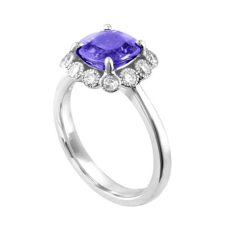 Beautiful Halo Ring The ring is 14K White Gold The Center Stone is a Violetish Blue Sapphire 2.59 Carats NO HEAT The Sapphire is AGL Certified There are 0.51 Carats in Diamonds G SI The ring is a size 6.5, sizable The ring weighs 5.0 grams