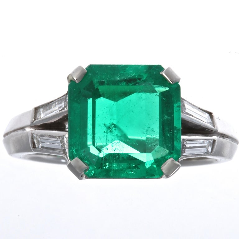 This attractive Gubelin made ring features a well saturated Colombian emerald. The best of Colombian emeralds exhibits this rich green color.  The AGL certificate states that the emerald weighs 2.60 carats is from Colombia and has minor oil