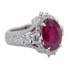 AGL Certified 5.51 Carat Burma Ruby Oval Cut in Platinum 2.04 Carat Ring